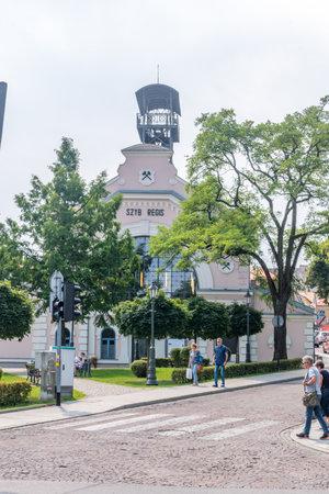 Wieliczka, Poland - July 27, 2019: View in Wieliczka city with Wieliczka Salt Mine - Regis Shaft in background.