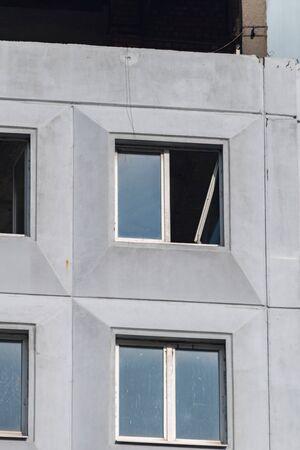 Kaliningrad, Russia - August 4, 2019: Destroyed window of unfinished building.