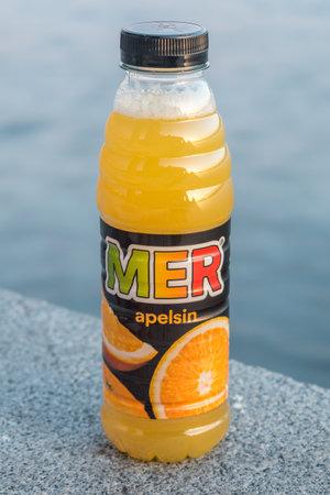 Stockholm, Sweden - September 24, 2019: Bottle of MER orange drink.