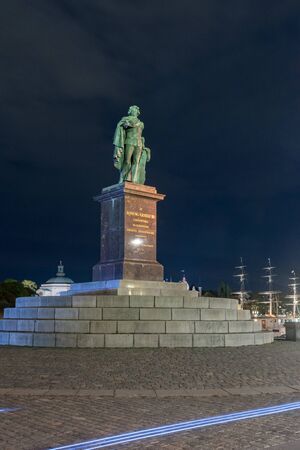 Stockholm, Sweden - September 24, 2019: Gustav as Apollo Belvedere dressed in the uniform of the Swedish Coastal Navy (Skargardsflottan) at night.