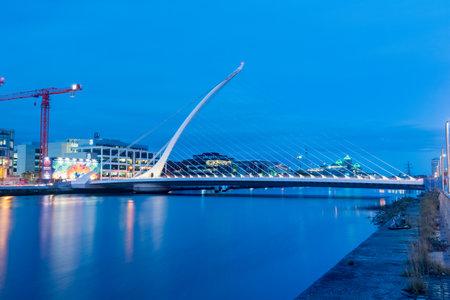 Dublin, Ireland - November 5, 2019: Docklands and Samuel Beckett bridge at night Editorial