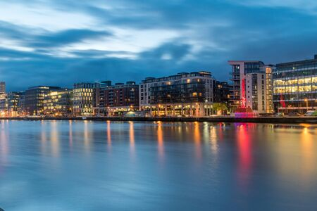 Modern buildings and offices on Liffey river in the morning in Dublin, Ireland.