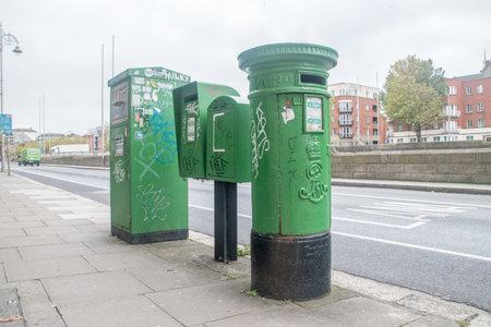 Dublin, Ireland - November 5, 2019: Green mailbox in Dublin.