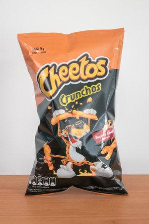 Pruszcz Gdanski, Poland - November 16, 2019: Cheetos Crunchos Sweet Chilli flavor Snacks Chips. Редакционное
