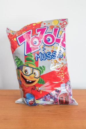 Pruszcz Gdanski, Poland - December 6, 2019: Bag of Zozole cola flavoured muss sweets. Редакционное
