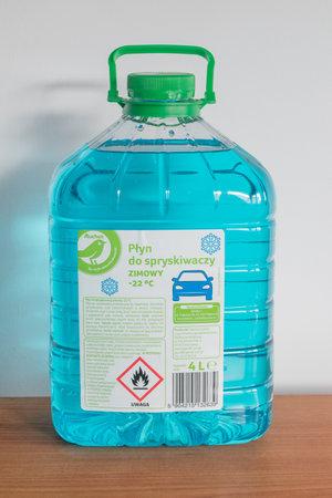 Pruszcz Gdanski, Poland - December 7, 2019: Auchan Bottle of blue antifreeze windshield washer fluid. Редакционное