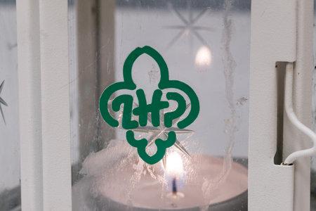 Pruszcz Gdanski, Poland - December 22, 2019: Logo of Polish Scouting and Guiding Association (Polish: ZwiÄ…zek Harcerstwa Polskiego, ZHP) at Peace Light of Bethlehem. Редакционное
