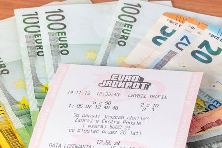Pruszcz Gdanski, Poland - November 26, 2019: Eurojackpot ticket with euro banknotes. Eurojackpot is a transnational European lottery.