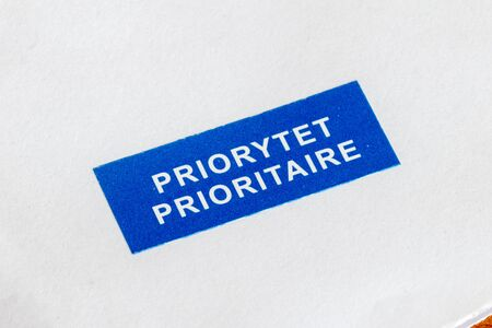 Blue sticker with the word priority on the list. Stock Photo