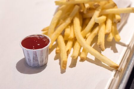 Ketchup with salted crispy potato french fries.