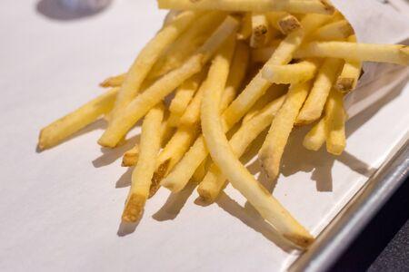 Salted crispy potato french fries.