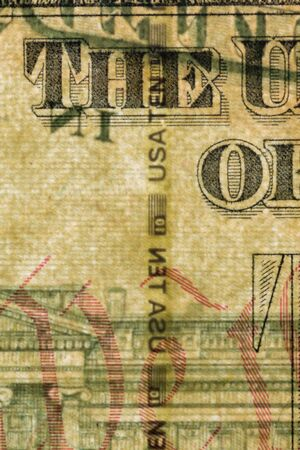 Plastic security strip inside 10 USD banknote. Security strip on American banknote created to prevent counterfeiters.