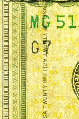 Plastic security strip inside 20 USD banknote. Security strip on American banknote created to prevent counterfeiters.