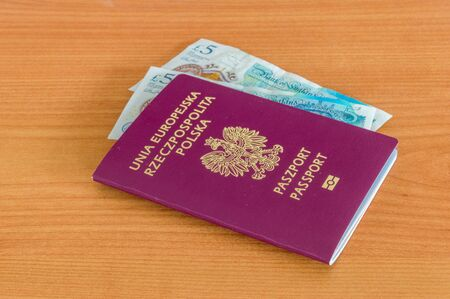 Polish biometric passport with Pound sterling banknotes.