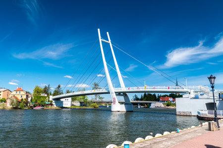 Mikolajki, Poland - June 1, 2020: Foot and bicycle bridge on the lake in Mikolajki.