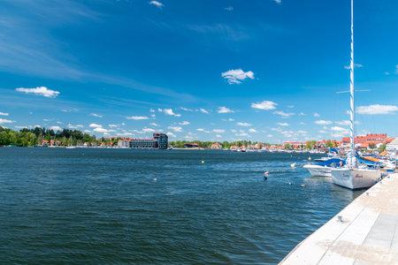 Mikolajki, Poland - June 1, 2020: Summer view of Mikolajki with Mikolajskie lake. Publikacyjne