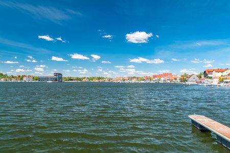Mikolajki, Poland - June 1, 2020: Beautiful summer view of Mikolajki with Mikolajskie lake.