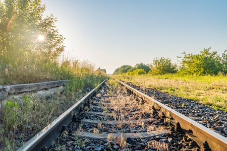 Railway station and beautiful sky at sunrise. Фото со стока