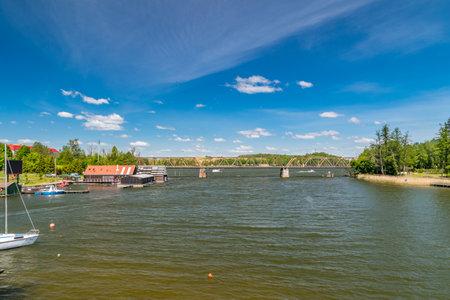 Mikolajki, Poland - June 1, 2020: Railway bridge over lake. Publikacyjne