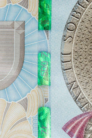Plastic security strip on 500 PLN banknote. Security strip on Polish zloty banknote created to prevent counterfeiters.