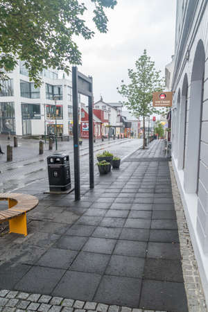 Reykjavik, Iceland - June 20, 2020: Street in downtown at rainy day.