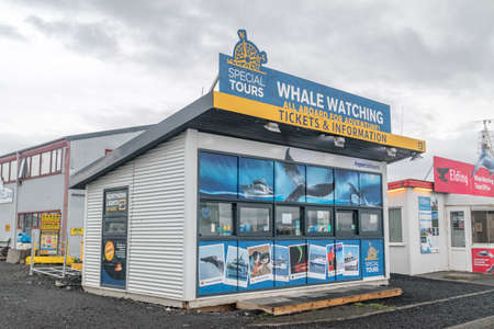 Reykjavik, Iceland - June 20, 2020: Ticket office and information about tours for whale watching in Reykjavik harbor.