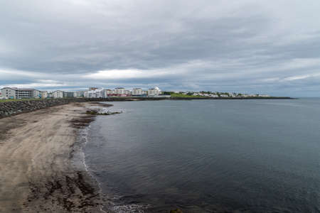 Beach at cloudy day in Reykjavik, Iceland.