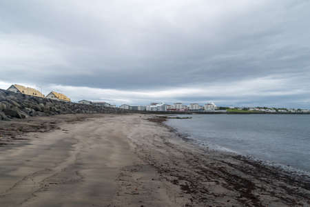 View sea on beach at Reykjavik at cloudy day. Stock fotó