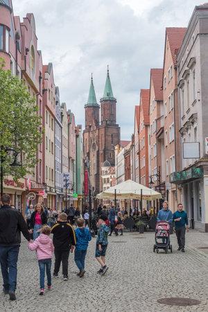 Legnica, Poland - June 1, 2021: Crowded Blessed Virgin Mary (Polish: Najswietszej Maryi Panny) street.