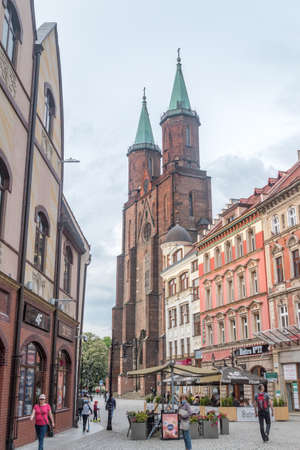 Legnica, Poland - June 1, 2021: Street view with Saint Mary Lutheran church.