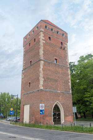 Legnica, Poland - June 1, 2021: Glogow Gate Tower near Piast castle. Editorial