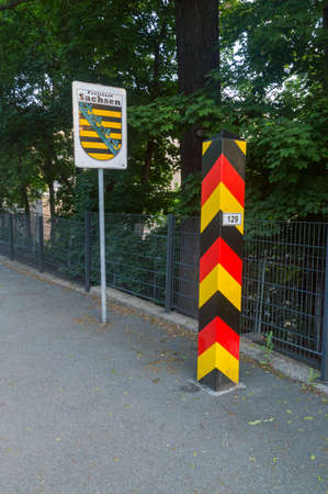 Gorlitz, Germany - June 2, 2021: German Territorial sign and coat of arms of Saxony in Gorlitz city. Border post near border between Poland and German. Editorial