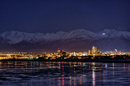 anchorage: Anchorage, Alaska, at night across from Cook Inlet.