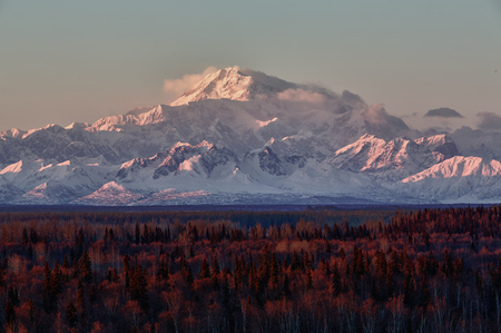 denali: Mount McKinley at sunset. Also known as Denali, the mountain which is in Denali National Park in Alaska, is 20,322 feet and the tallest mountain in North America.