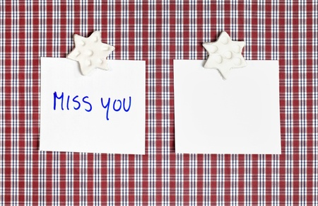 Sheet of paper on textile backround with message. photo