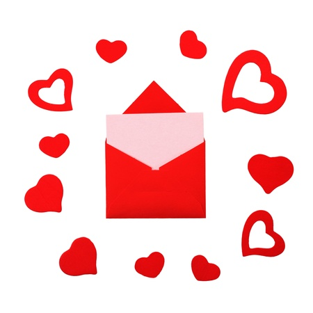 Red paper envelope with pink card and hearts isolated on white background. Stock Photo - 12026396