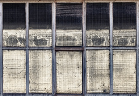 Old broken windows in a partially demolished abandoned factory. Stock Photo - 12106334
