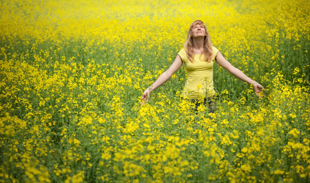 Yellow rapeseed field with woman
