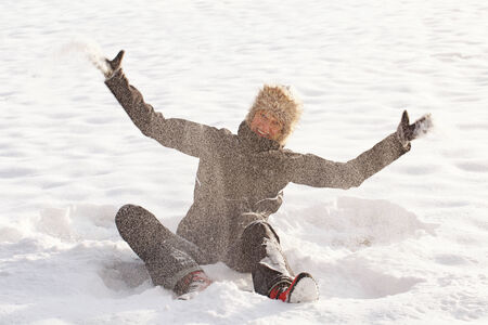 Women throwing snow and play in it  Stock Photo