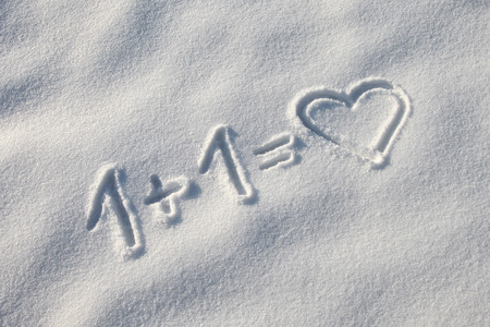 Winter valentine tracks with love heart in fresh snow  Stock Photo
