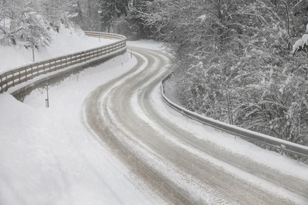 Snowy winter street road with turn  Stock Photo