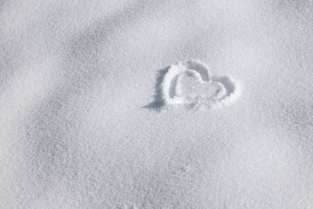 Winter heart sign in the snow  Stock Photo