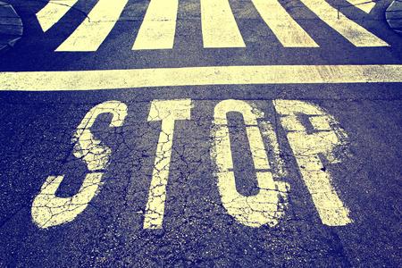Vintage stop sign on city asphalt floor.