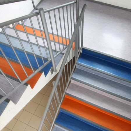 staircase structure: School colorful staircase structure details with fence. Stock Photo