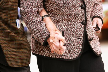 old people: Old hand supporting old hand-helping elderly people. Stock Photo