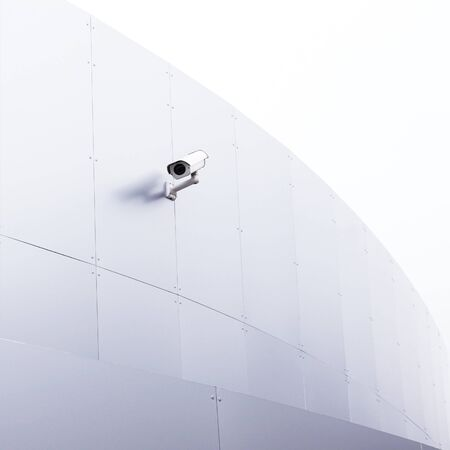 big brother spy: Closeup of white securitiy camera on the new silver magenta building. Stock Photo