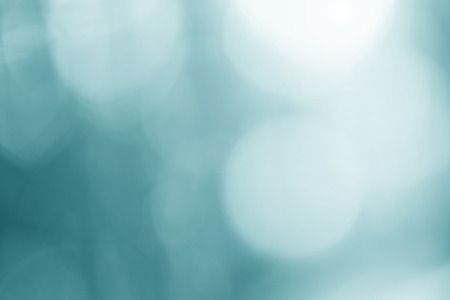 Abstract bokeh turquoise color light blurry background. Imagens
