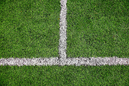 Football field detail with white lines. Stock Photo
