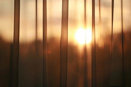 shining through: Sun shining through curtain.