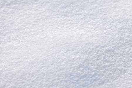 Abstract fresh snow texture detail background. Selective focus used.